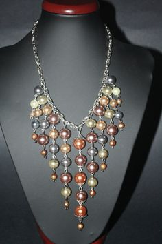 Beautiful Hanging Pastel Colors Pearls Necklace.. $40.00, via Etsy.