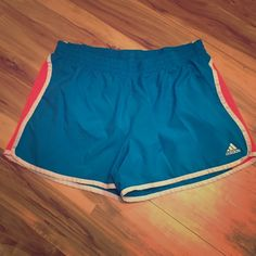 Adidas ClimaLite Neon Color Lined Women's Shorts Nice pair of Adidas neon blue and pink lined women's shorts. Nice clean liner and lightweight fabric. Size medium in great condition Adidas Shorts