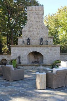 Lovely outdoor sitting area with fireplace, by Jones Group Interiors, Akron, OH.