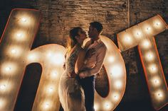 """Houghton real bride Danielle in her sparkly metallic ombré sequin """"Tati"""" wedding dress in London Sparkler Candles, Sparklers, Houghton Bride, Light Up Letters, Marquee Letters, Bridal Gowns, Wedding Dresses, Marquee Wedding, London Wedding"""