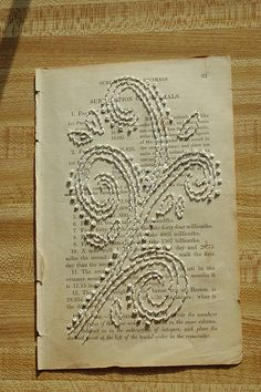 this is gorgeous. and it's on a page of an old math book.... takes doodling on your homework to a whole new (awesome) level! :) Now off to check out her etsy shop...