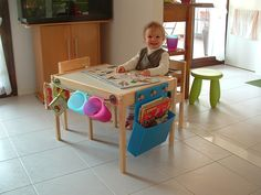 hacked ikea play table to add storage and organization. Nice!