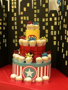 Superhero  CupCake Tower DIY: If you do not want to pay for 3 tiers cakes which costs a BOMB, here s an idea to display Super cupcakes instead.
