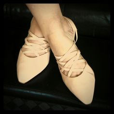 Ballerina pink strappy heels Pointed closed toe kitten heel with criss cross pattern design, slingback backing, the color is a light pink leather. Fits more of an 8 1/2 than a 9  due to narrowness of the shoe Nine West Shoes Heels
