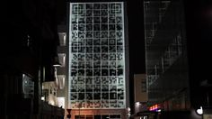 At night, a QR code is projected on the building and allows city-dwellers to scan the building with their phones. Something happens to the building for viewers to enjoy on their screens.
