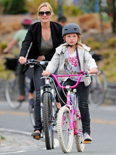 Kate Winslet biking with her daughter Mia in New York City.