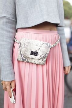 Pink maxi dress with pleats and light greay crop top with long sleeves from London Fashion Week street style