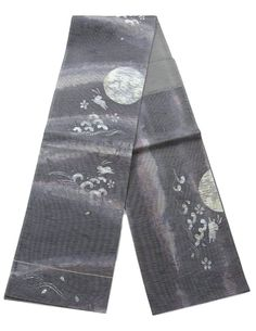 This is a fashionable Fukuro obi with large full Moon, rabbit and wave design, which is woven.  Washi(Japanese paper) is woven and show distinctive atmosphere
