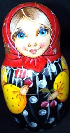 Matryoshka (Russian nesting doll) in a red shawl with some cherries in its hands.