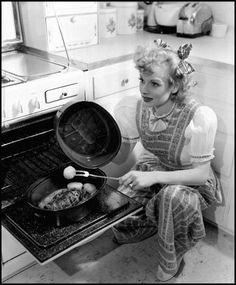 Vintage 1940's black & white photo of Lucille Ball cooking dinner