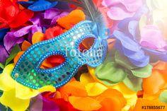 """Téléchargez la photo libre de droits """"Sequined blue carnival mask sits on bright background of rainbow colored flower leis"""" créée par lazyllama au meilleur prix sur Fotolia.com. Parcourez notre banque d'images en ligne et trouvez l'image parfaite pour vos projets marketing !"""