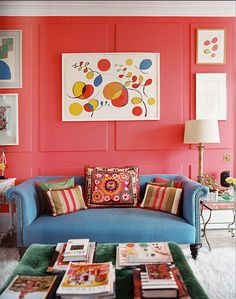 Cheap Home Decor Artworks on the red wall enliven this eclectic living room.Cheap Home Decor Artworks on the red wall enliven this eclectic living room Living Room Red, Colourful Living Room, Living Room Photos, Eclectic Living Room, Interior Design Living Room, Living Room Designs, Living Room Decor, Living Area, Deco Boheme Chic