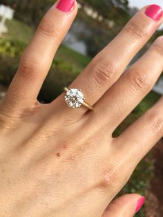 My engagement ring! Round brilliant solitaire 6 prong 14k yellow gold.