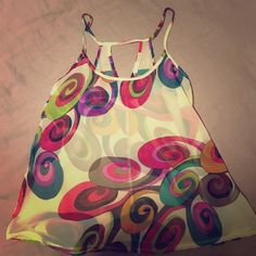 Boutique Retro-Inspired Tank Adorable swingy retro tank purchased from a boutique! Just too small for me. This is a sheer tank with a cute keyhole in the back. Tops Tank Tops