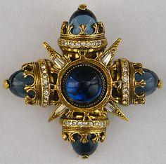 Currently on Ebay.  This is the first time I've seen the cabochon version in blue with the dark gold finish.  The stones are nice and clear too - stunning! I already have a blue so you won't be bidding against me  :)