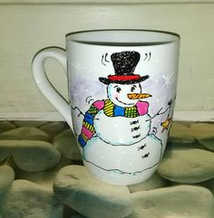 Handpainted mug. Snowman with scarf, snowflakes and snow.