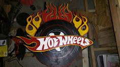 Hot wheels logo made out of wood.