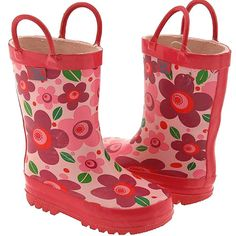 Colorful girls rain boots featuring vibrant purple and pink flowers on a pink background with bright pink soles and handles.