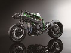 2015_Kawasaki_Ninja H2R_4.med We didn't think we'd see a 300 hp motorcycle, but the H2 is living up to its hype. This power number makes the Ninja H2R the highest-horespower motorcycle ever manufactured, beating out Kawasaki's own ZX-14R. We aren't sure of the power output of the H2 street-version yet or if it'll feature the full carbon fiber body, but we'd bet those power numbers will also beat out the ZX-14R. Kawasaki Ninja H2r, Motos Kawasaki, Kawasaki Motorcycles, Concept Motorcycles, Vespa, Kawasaki Heavy Industries, Super Bikes, Bike Design, Tamiya