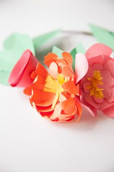 the prettiest paper flower crowns you ever did see ... made out of construction paper! You won't believe how easy they are, kids can even make them