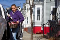 Kali Thomas delivers Meals on Wheels to an elderly person. The food delivery service for seniors living at home can help save millions of dollars by keeping many elderly people out of nursing homes, according to a new study.