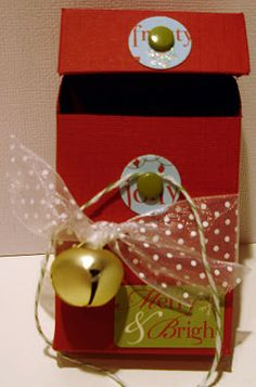 """To Finish the box: Punch out two 3/4"""" circles. Glue to box. Insert brad through each circle. Tie 18"""" of twine or string to bottom brad, wrap around & tie so the knot is hidden. I tied 12"""" of ribbon around jingle bell also added embellishment sticker."""