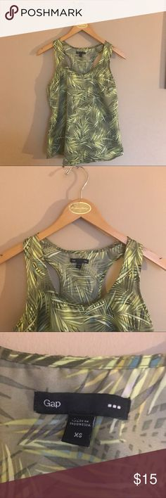 GAP palm printed summer polyester silky racer tank GAP palm printed summer polyester silky racer tank. Soft and beautiful silky polyester sleeveless summer top tank. Simple and beautiful. Bundle with other summer tops in my closet for a bundle discount! I love reasonable offers, bundle and save! 🌴🌴🌴 GAP Tops Tank Tops