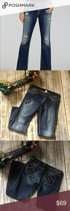 Silver Women's Wide Bottom Jeans Dark  Blue Tint Jeans distressed look. Wide flare bottoms. Size waist 32 length 31 . In excellent used condition.very stylish quality jeans! Silver Jeans Jeans Flare & Wide Leg