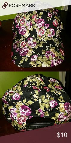 Floral Hat Black background with magenta, red, green and yellow floral print. Worn once. Snap back closure. Perfect condition.  **SHIPS NEXT BUSINESS DAY** Wet Seal Accessories Hats