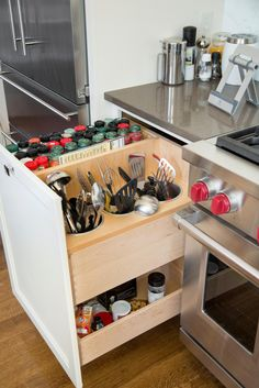 A place for everything, and everything in its place makes a happy kitchen. To create kitchen happiness for these homeowners, designers used drawers disguised as cabinets to help make the best of the space, while maintaining a stylish, modern facade.