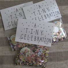 A TINY CELEBRATION - CR26a small packet of hand picked confettifor when even the smallest victories need to be acknowledgedabout 1/2 ounce of confettiincluding gold, silver, iridescent and glow in the dark circles, moons and stars