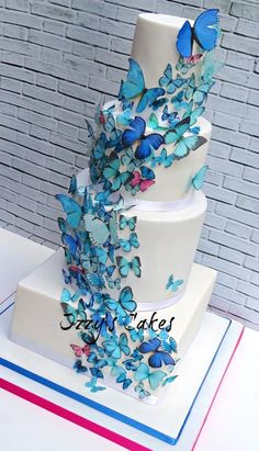 Blue Butterflies Wedding by Izzy's Cakes - http://cakesdecor.com/cakes/209305-blue-butterflies-wedding