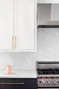 Marble Slab Backsplash. The countertops and continuous backsplash are marble.