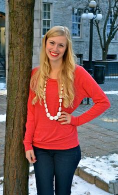 Stay comfy in a casual knit but pair it with a blingy necklace to dress it up