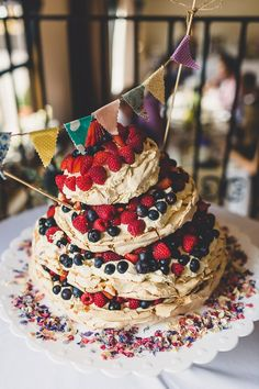 Layered strawberry, raspberry and blueberry pavlova wedding cake. Delicious!!