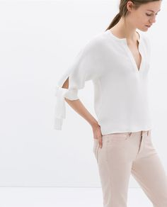 A timeless top. Love the arm tie detail. Wear through 3 seasons. Can always pair with a pencil skirt and booties in the winter.