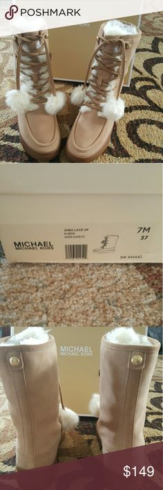 NIB MICHAEL Michael Kors winter boots Size 7. Adorable Michael Kors Juno lace up boots with fur accents. Dark khaki. Size 7. NIB Michael Kors Shoes Winter & Rain Boots