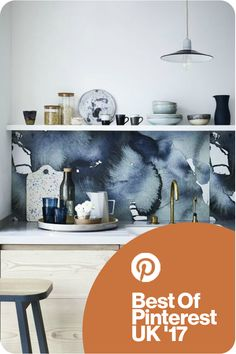 We're delighted to have won Best Kitchen Design at the Best of Pinterest UK Interior Awards 2017. This inky blue watercolour splashback makes a stunning focal point in this simply chic kitchen scheme. Get more kitchen and decoration ideas at housebeautiful.co.uk. #BestOfPinterestUK