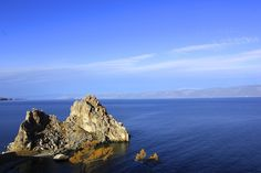 Traveling Olkhon Island on Lake Baikal. This was another view of the rock outcropping taken from the other side of the cliff we were on. We tried to catch this at sunset later that day. Lake Baikal Russia, The Other Side, Cliff, The Rock, Planets, Traveling, Tours, Island, Sunset