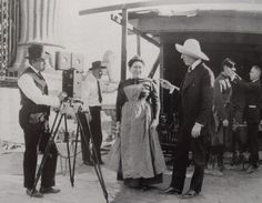 Billy Bitzer, Josephine Crowell, director D. W. Griffith & Erich von Stroheim on the set of Intolerance, 1916.