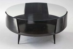 Round ebonzed wood coffee table with glass top. By Carlo Hauner and Martin Eisler for Forma, Brazil, 1950s.
