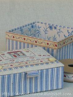caixas encapadas com tecido e bordado