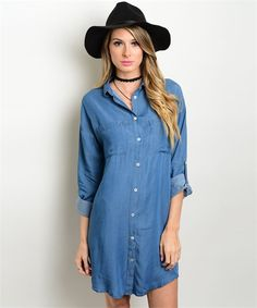 """This chambray shirt-dress features a button up style, adjustable length sleeves and a relaxed fit. Fabric Content: 100% Tencel. Can be worn """"as shown"""" or belted for a more fitted look. Small measures"""