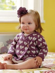 Knit this beautiful overlap cardigan, with a cute heart pattern throughout, for an ideal pull on for a little girl.