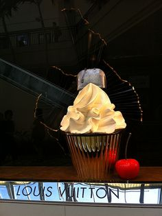 A giant cupcake in the window of Louis Vuitton at the open air mall Ala Moana Center in Honolulu, Hawaii