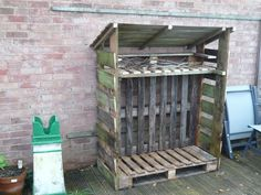 Log store built from recycled palettes (bottom, kindling shelf and back panels) and fence panels supported by a frame of spare planks. Provides good aeration. Don't forget to allow for a decent overhang on the roof.