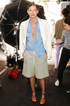 Jenna Lyons' in an unbuttoned chambray top and printed bermuda shorts