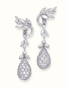 A PAIR OF DIAMOND EAR PENDANTS Each designed as a pavé-set diamond drop-shaped pendant to the circular and marquise-cut diamond floral detachable surmount, with marquise-cut diamond three-stone spacers, suspended from a marquise and circular-cut flower top
