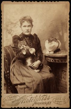 onceuponatown:  A young woman with two feline friends. Norwich, New York. 1890.