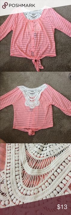 Rue 21 lace crop top Lace at the belly bottom crop top, more than a half sleeve, buttons down but doesn't come apart. NEVER WORN without tags Rue 21 Tops Crop Tops